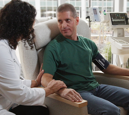 Dr. Casey Moffa, D.O., visits with a patient