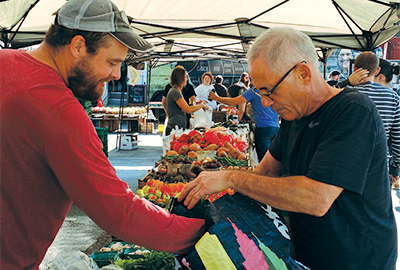 Two men at a farmer's market