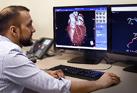 Dr. Moneal Shah studies the results from the HeartFlow Analysis