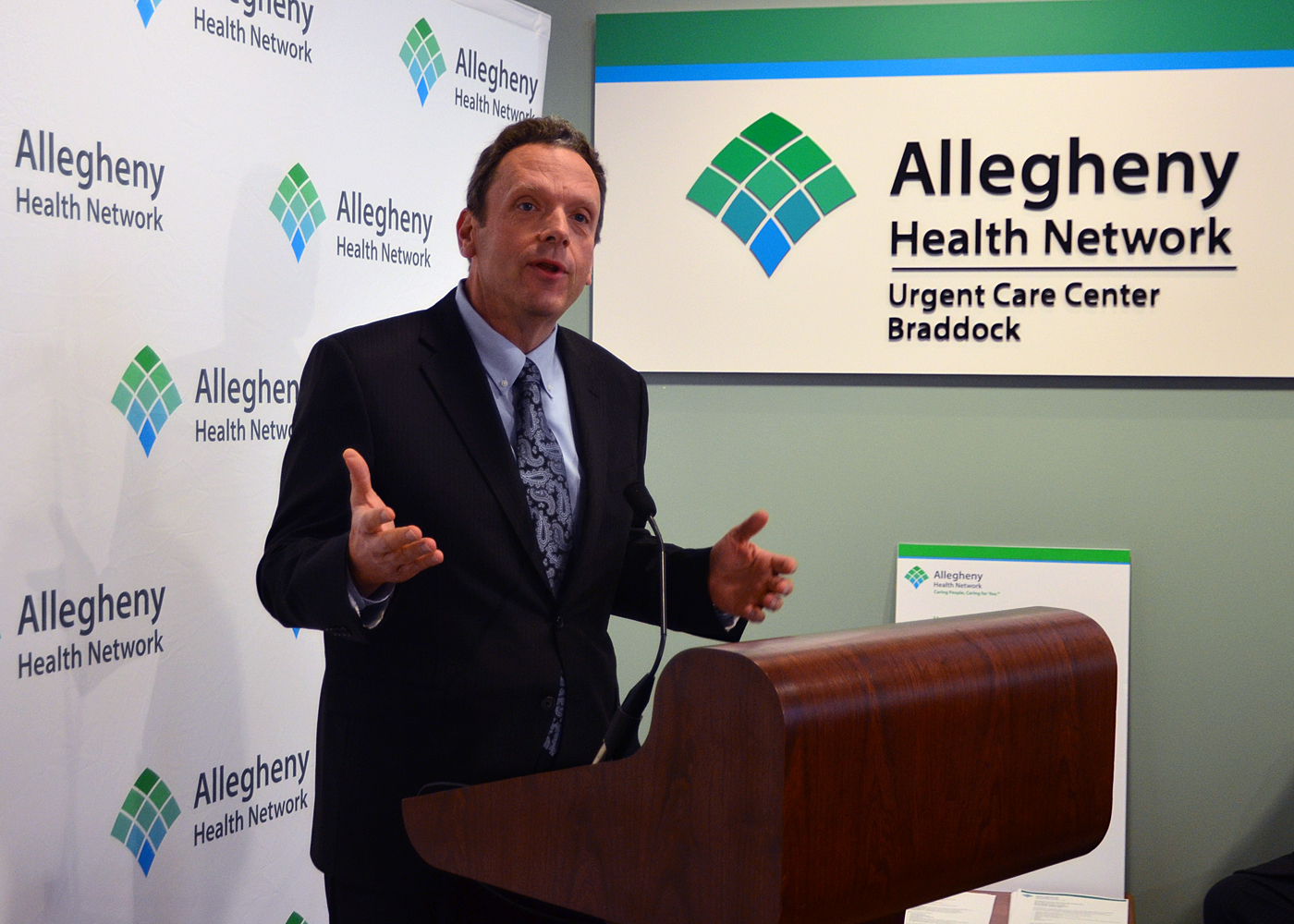 CEO David Holmberg speaking at Allegheny Health Network Urgent Care Center in Braddock