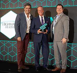 L to R: Master of Ceremonies Fernando Machado, CMO with Burger King; Highmark Health's Gary Foster, VP of Procurement and Procurement Leader award winner; Eric Weitz, Senior Account Director with event sponsor Coupa.