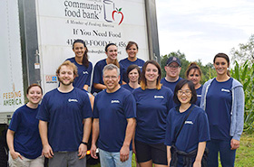 employee volunteers at food bank