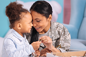 military woman with girl
